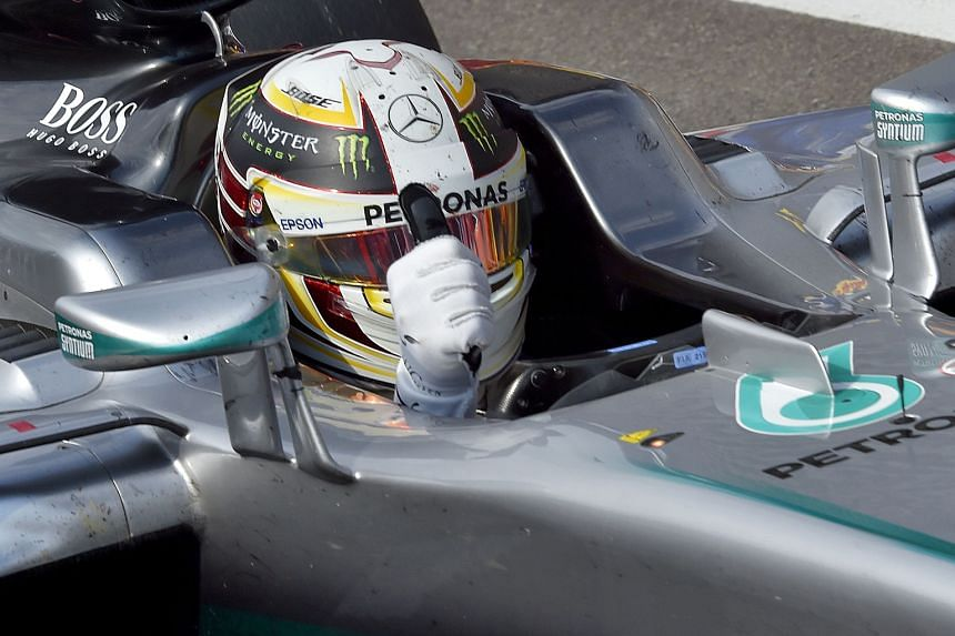 Mercedes' Lewis Hamilton giving the thumbs-up at the end of the Belgian Grand Prix on Sunday. The world championship leader finished third, despite starting the race in 21st place on the grid.