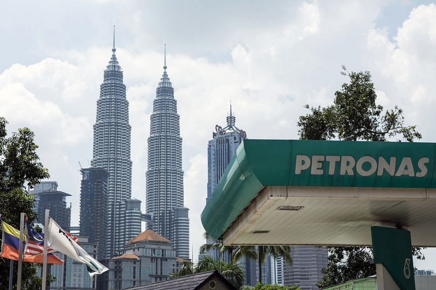 A Petronas petrol station in front of the Malaysian state oil company's flagship Petronas Twin Towers in Kuala Lumpur.