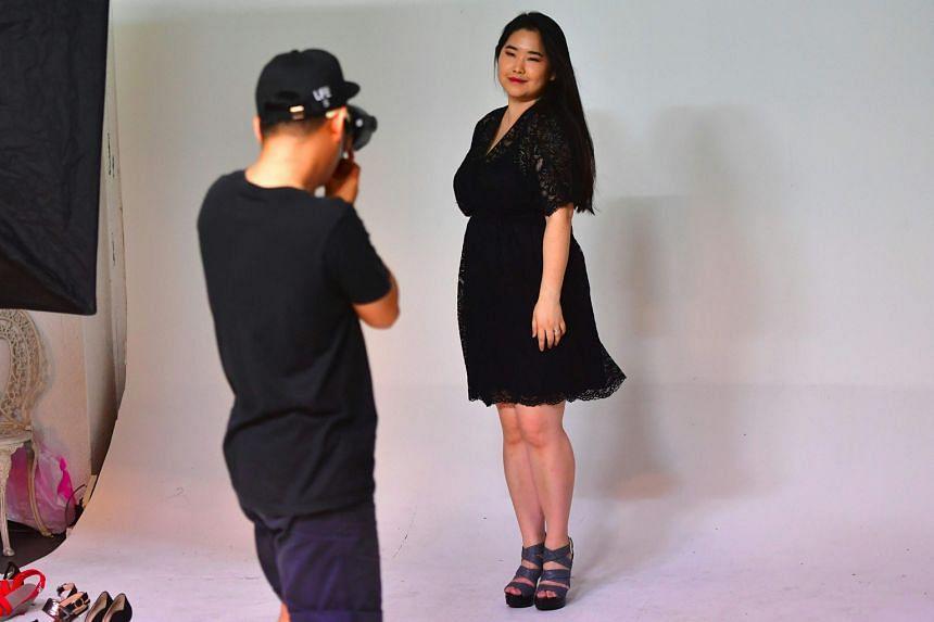 South Korean plus-size model Vivian Geeyang Kim posing for a photo shoot to update her online shop in Seoul.