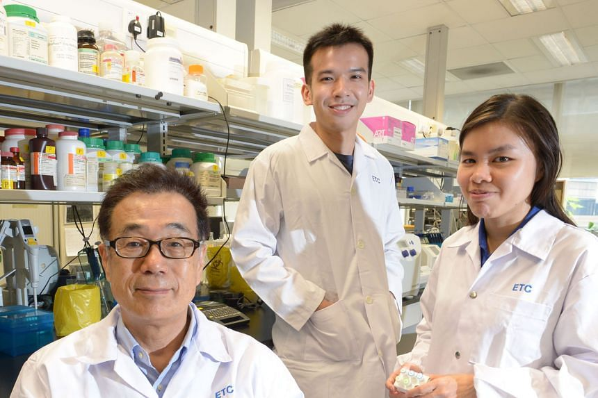 A*Star Experimental Therapeutics Centre's senior research scientist Masafumi Inoue (left) and research associates Gerald Yong and Karen Lee were part of the team behind the kit that can test for dengue, chikungunya and Zika at the same time.