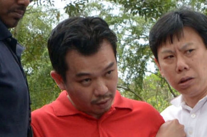 Police officers taking Lee to Sembawang Park during investigations in 2014. Lee had carried out recce trips to places he thought were good for collecting ransom cash, including Bottle Tree Village in Sembawang.