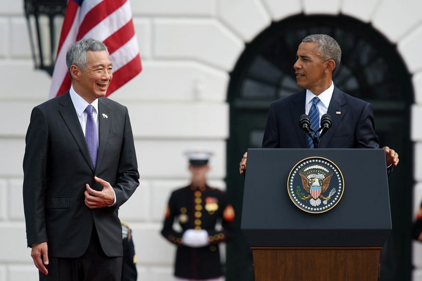 Mr Lee arrived at the White House on the morning of Aug 3 (far left) and was received by US President Barack Obama. He came back to Singapore on Aug 5 and days later attended the National Day Parade (left). Mr Lee spent the next few days at National