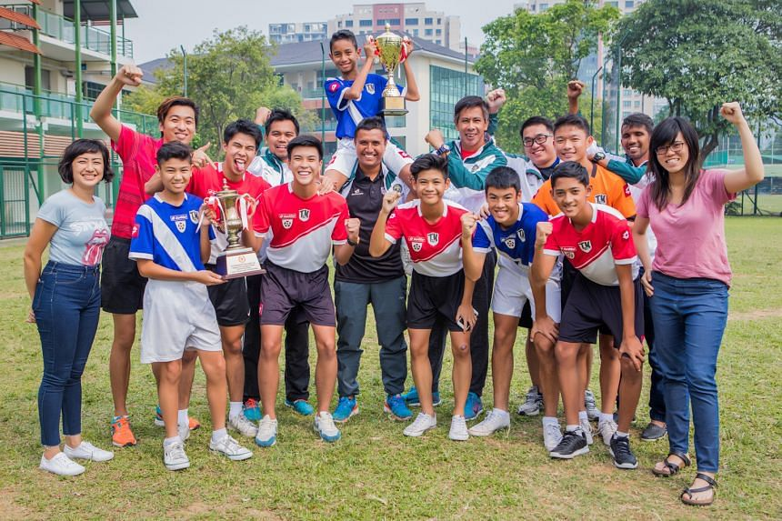 Tanjong Katong Secondary School left few stones unturned when it came to coaching their football teams, including employing the services of former Lions Noor Ali (second from right) and Rezal Hassan (back row, fourth from right) to complement B boys'