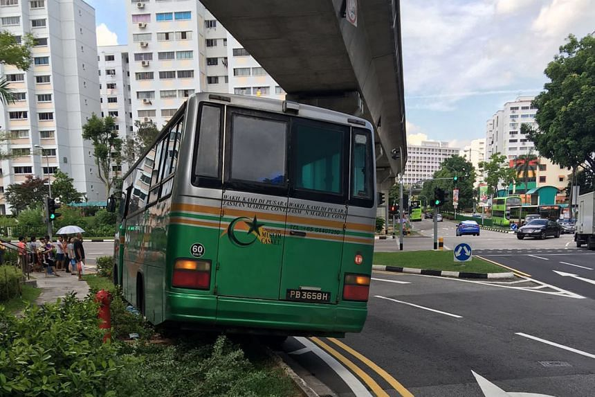 The bus from funeral services firm Singapore Muslim Casket and Marble Contractor that was involved in the accident.