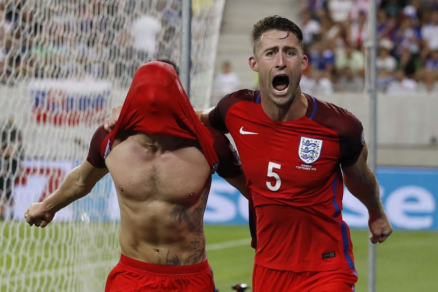 England's Adam Lallana (far left) celebrating with Gary Cahill after scoring his team's one and only goal in the 95th minute. Sam Allardyce's side prevailed over 10-man Slovakia for a winning start to England's 2018 World Cup qualifiers in Group F.