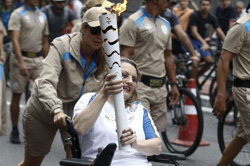 A Sao Paulo resident carrying the Paralympic torch through the streets of her city upon the flame's arrival on Sunday. The Rio Paralympic Games will be held from Sept 7-18.