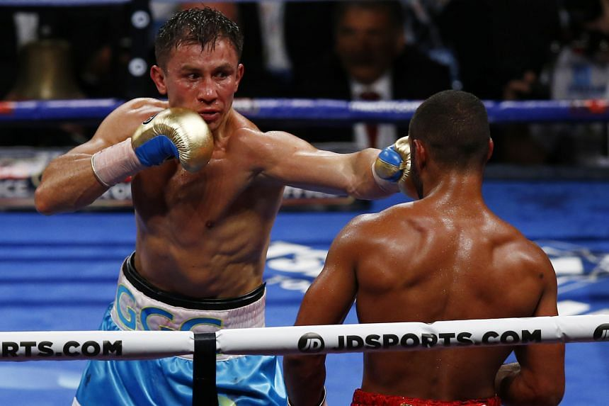 Gennady Golovkin punching Kell Brook during their WBC-IBF middleweight title fight on Saturday. Brook's camp threw in the towel.