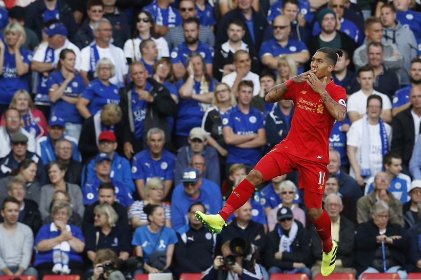"""Roberto Firmino celebrating after scoring his first goal in the Reds' 4-1 victory over Leicester City on Saturday. Jurgen Klopp said: """"Please don't sing my name before the game is decided."""""""