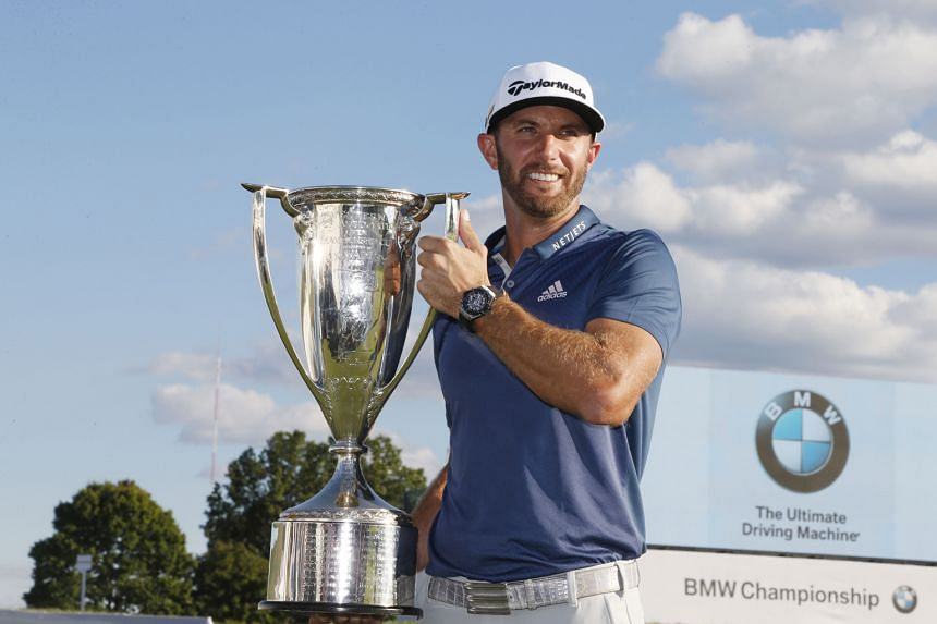 Dustin Johnson holding the Western Golf Association Trophy for winning the BMW Championship, his third win this year. The world No. 2 golfer will be in Atlanta in a fortnight to play in the season-ending US$10 million Tour Championship.