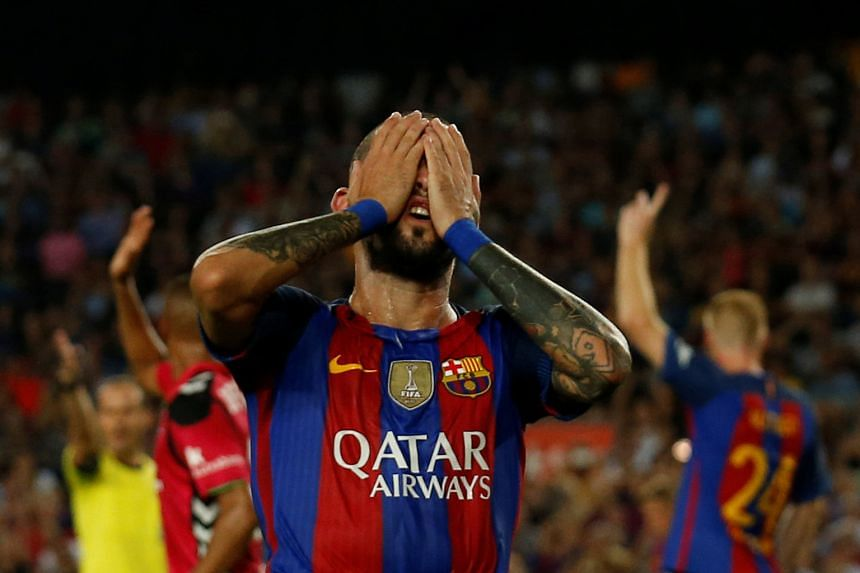 Aleix Vidal showing the strain with Barcelona heading for a 2-1 reverse against Alaves in La Liga. Manager Luis Enrique dismissed rumours of a split in his squad over his move to make eight changes to the team ahead of tonight's European game against