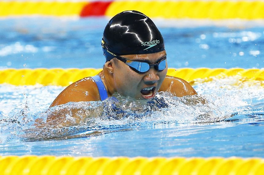 Above: Theresa Goh battling her way to a bronze in the 100m breaststroke SB4 final at the Olympics Aquatics Stadium in Rio. Left: Yip Pin Xiu and Goh shedding tears of joy together after the latter's swim.
