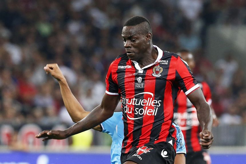 Nice striker Mario Balotelli evading the challenge of Marseille's William Vainqueur. The Italian opened his Ligue 1 account with a double to help his side to a 3-2 win, ending his year-long goal drought.