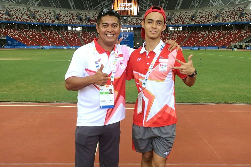 Muhamad Hosni (left) says Suhairi Suhani is one of the few athletes he has coached to bargain for shorter breaks. The coach said, however, that the long jumper getting a job might stand in the way of him training full-time.