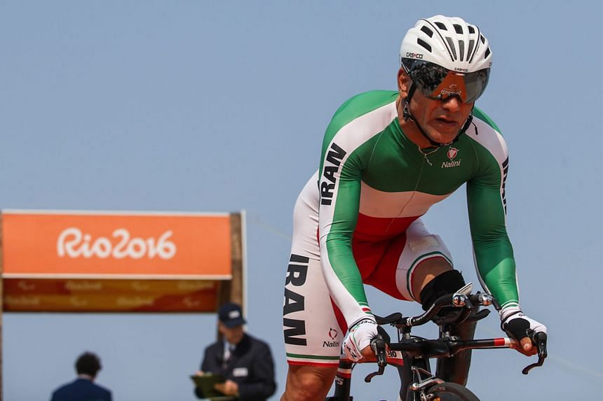 Cyclist Sarafraz Bahman Golbarnezhad of Iran shortly after the start of the men's road race C4-5. He died on Saturday after crashing during the race and suffering a subsequent cardiac arrest.