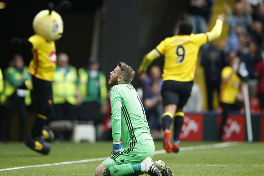 Watford striker Troy Deeney celebrates after scoring from the penalty spot in stoppage time as Manchester United goalkeeper David de Gea reflects on conceding three goals at Vicarage Road.