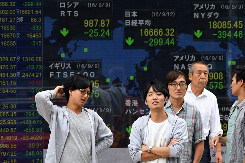 A monitor showing stock market indices in Tokyo last week. Speculation over whether the US Federal Reserve will raise interest rates and uncertainty over the Bank of Japan's monetary policy have roiled regional equities.