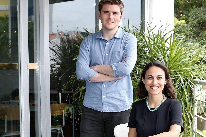 Stripe founder John Collison, seen here with country lead for Singapore Piruze Sabuncu, says the service simplifies payments and fees for businesses online.