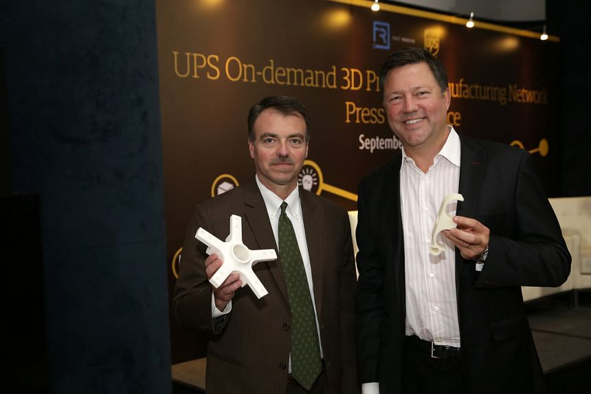 UPS Asia-Pacific president Ross McCullough (left) and Mr Rick Smith, co-founder and chief executive of additive manufacturing specialist Fast Radius, with 3D-printed prototypes. The Singapore facility, to be set up in November, will be the first inte