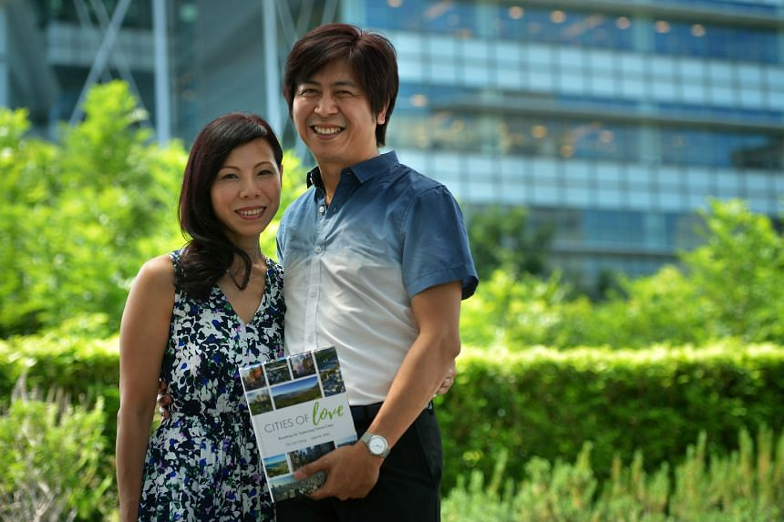Mr Tai and wife Valerie with their book, Cities Of Love, which aims to show how city dwellers can play a part in contributing to the sustainability of cities worldwide.