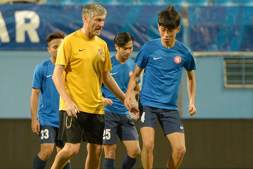 Young Lions coach Patrick Hesse giving instructions to Joshua Pereira (front) during a training session yesterday. The Young Lions, who are sitting bottom of the S-League table, will face sixth-placed Hougang United tonight at the Jalan Besar Stadium