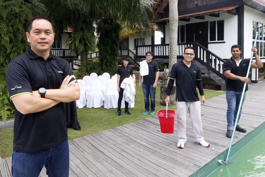 """Director of Garden Asia Kenny Eng (foreground) with staff who help run his farmstay project. Together with events management and a bistro, it complements his core business. He calls this """"hortitainment""""."""