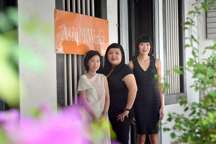 Asia PR Werkz's founder and managing director Cho Pei Lin (centre), and directors Sharon Koh (right) and Lim Wee Ling.