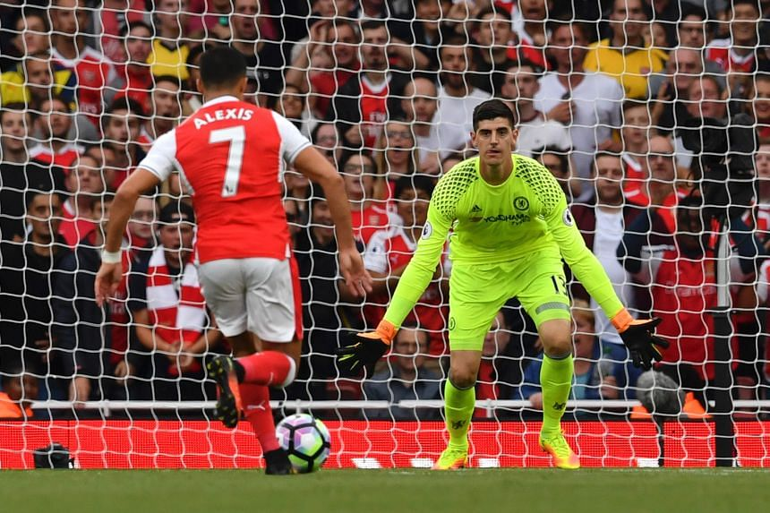 Arsenal's striker Alexis Sanchez zooming in to score the opener past Chelsea's goalkeeper Thibaut Courtois. This was the first league goal Arsenal netted against Chelsea since January 2013.