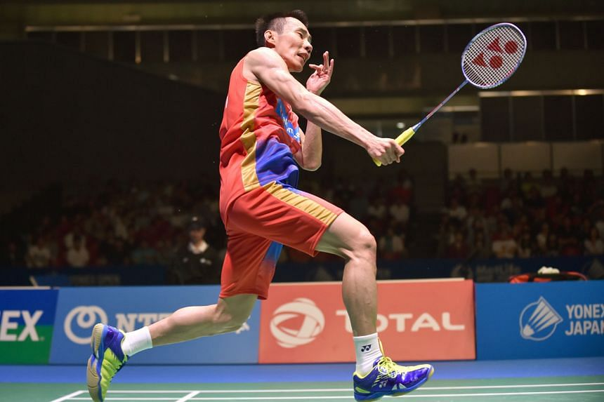 Malaysia's Lee Chong Wei smashing at Denmark's Jan Jorgensen in the Japan Open final yesterday. His win gave him his 65th career badminton title.