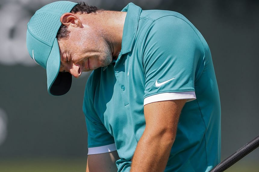 A flustered Rory McIlroy after missing his eagle putt on the par-five 18th in the third round of the Tour Championship, the finale of the FedExCup play-offs. He reached the green in two but was unable to sink the 13-yard putt, coming up one yard shor