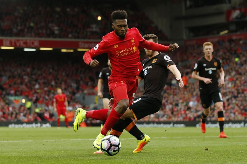 Substitute Daniel Sturridge earning Liverpool a penalty against Hull City's Andrew Robertson, who was taken in by the striker's dancing feet and brought him down. James Milner scored his second spot kick of the game to complete the Reds' 5-1 win, han