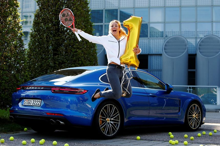 Angelique Kerber leaping with a balloon marking her rise to the top of tennis rankings. The German eased American Serena Williams' 186-week stranglehold on the position by winning the US Open earlier this month.