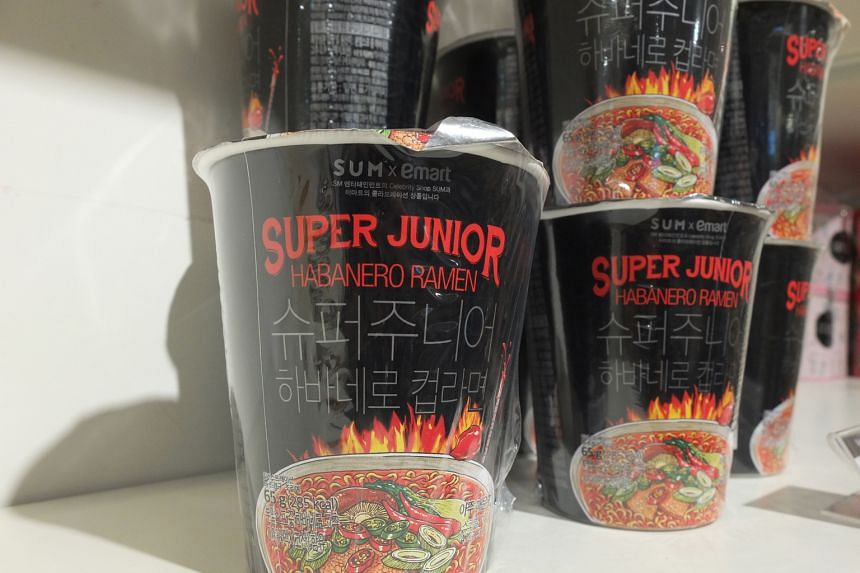 Tapping Korean soft power: A gift shop at SMTOWN and (above) food items, bearing names of pop bands, sold at SMTOWN Cafe.