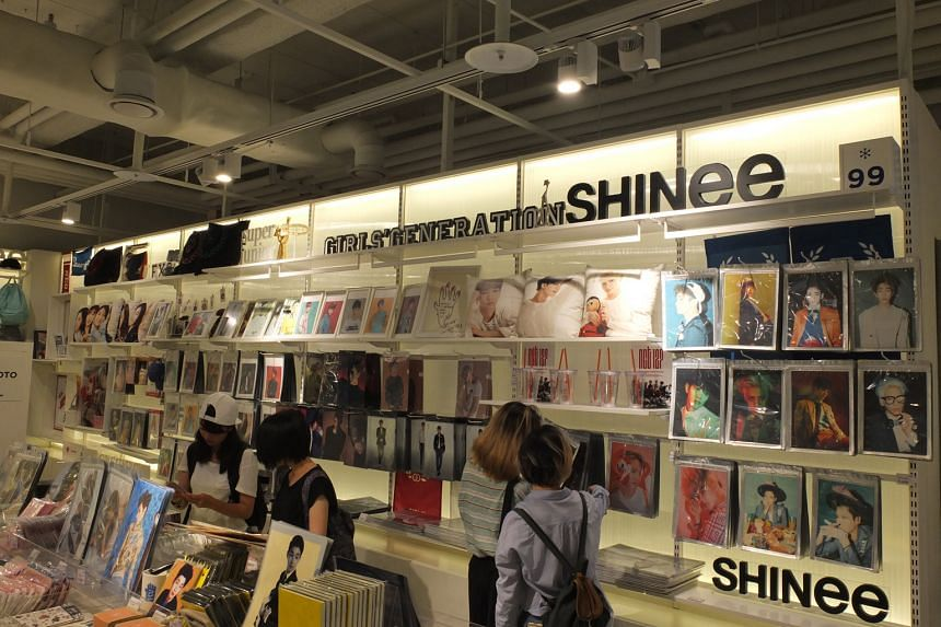 Tapping Korean soft power: (Above) A gift shop at SMTOWN and food items, bearing names of pop bands, sold at SMTOWN Cafe.