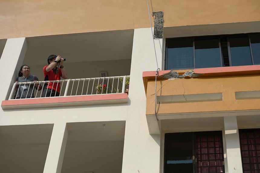 Cables supporting the sunshade on the third floor of Block 201E, Tampines Street 23 as a safety measure after the one above landed on it.