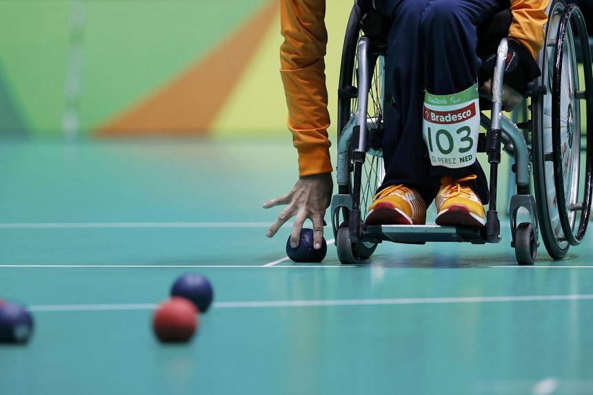 In boccia (above), players throw or roll balls as close as possible to a target ball. Boccia is one of the more popular disability sports in Singapore.