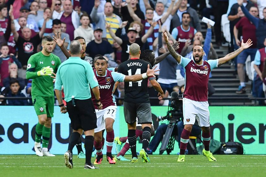 West Ham United midfielder Dimitri Payet and striker Simone Zaza (right) appealing for a penalty unsuccessfully in their 3-0 defeat by Southampton on Sunday.