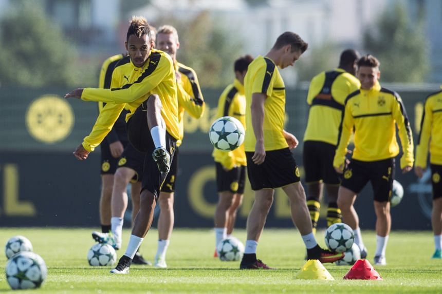 Borussia Dortmund's Pierre-Emerick Aubameyang (far left) taking part in a training session before his side's Group F Champions League clash against Real Madrid today.