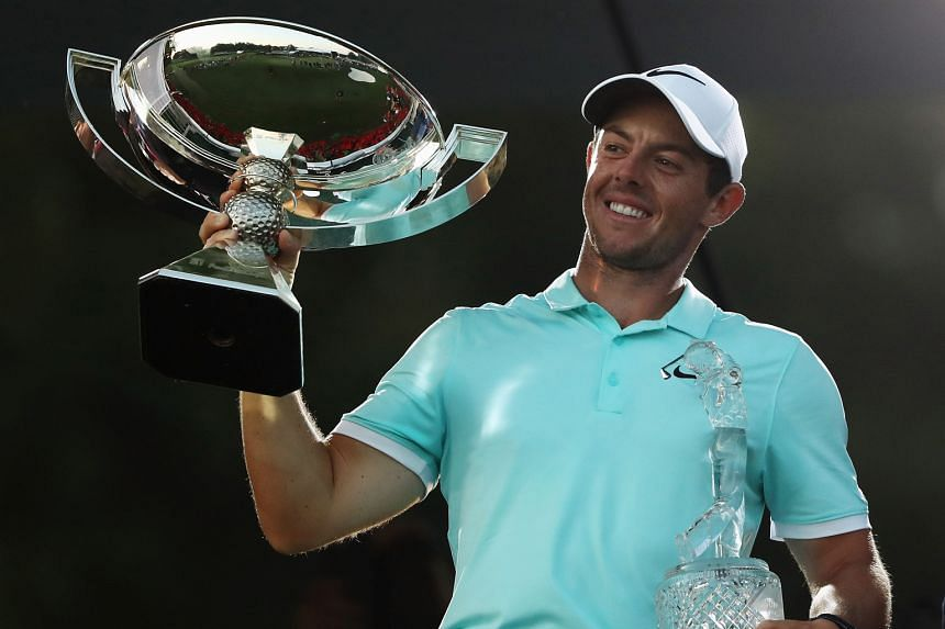 Rory McIlroy of Northern Ireland with the FedExCup and Tour Championship trophies, after his victory over Ryan Moore with a birdie on the fourth extra hole in the final round at East Lake Golf Club on Sunday. Despite mind games from the Americans, Eu