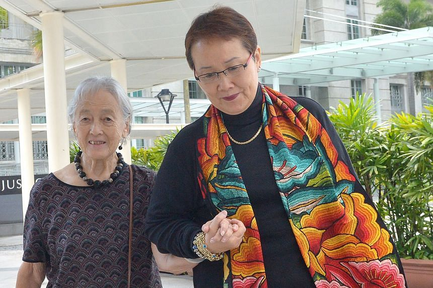 """Madam Mok and her aunt, Madam Chung, making their way to court yesterday. Madam Mok said she did not know the full extent of what Yang Yin had done """"until it was too late""""."""