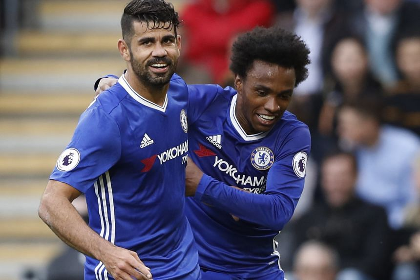 Chelsea striker Diego Costa celebrates scoring the visitors' second goal against Hull City in the 67th minute with team-mate Willian. Willian fired the Blues in front in the 61st minute of the Premier League game.
