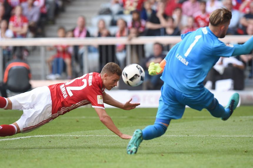 Bayern Munich's Joshua Kimmich dives to head the ball past Cologne goalkeeper Timo Horn. Anthony Modeste equalised in the second half to end Bayern's perfect start to the Bundesliga season.