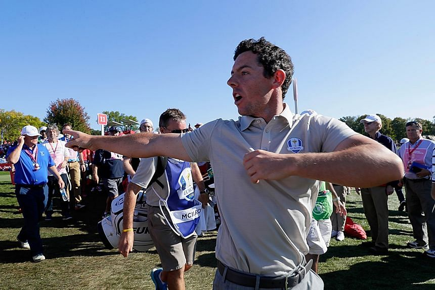 An angry Rory McIlroy arguing with a badly behaved spectator while walking to the 12th tee during the four-ball matches on Saturday.