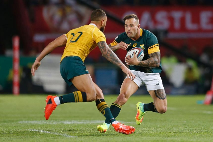 South Africa wing Francois Hougaard trying to get past Australia fly-half Quade Cooper during their Rugby Championship match in Pretoria, which the Springboks won 18-10. New Zealand have won the title but South Africa and Australia can both secure se