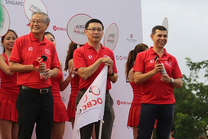 From left: OCBC bank chairman Ooi Sang Kuang, Singapore Cycling Federation president Jeffrey Goh, and The Straits Times editor Warren Fernandez flagging off The Straits Times ride.