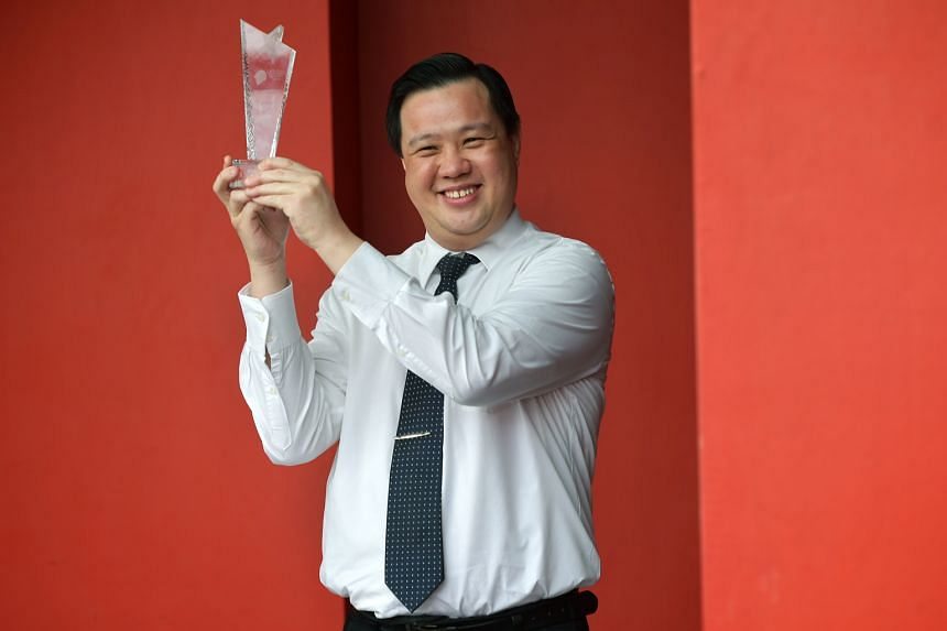 """Mr Norman Tan, a restaurant manager at Swensen's, won the top honour at the annual Excellent Service Awards yesterday for """"always going out of his way to ensure a memorable guest experience"""" - as his employer put it."""