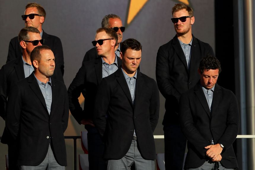 Team Europe players looking dejected at the closing ceremony of the Ryder Cup at Hazeltine National Golf Club.