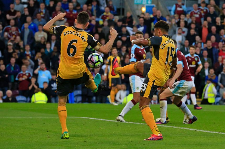 Arsenal's Laurent Koscielny deflecting the ball into the net from Alex Oxlade- Chamberlain's shot in their 1-0 Premier League win over Burnley on Sunday.