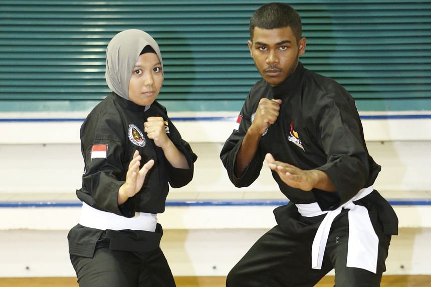 Singapore silat exponenets Nurul Khairunnisa Azlani (left) and Sheikh Farhan Sheikh Alau'ddin clinched golds for the Republic in Danang.