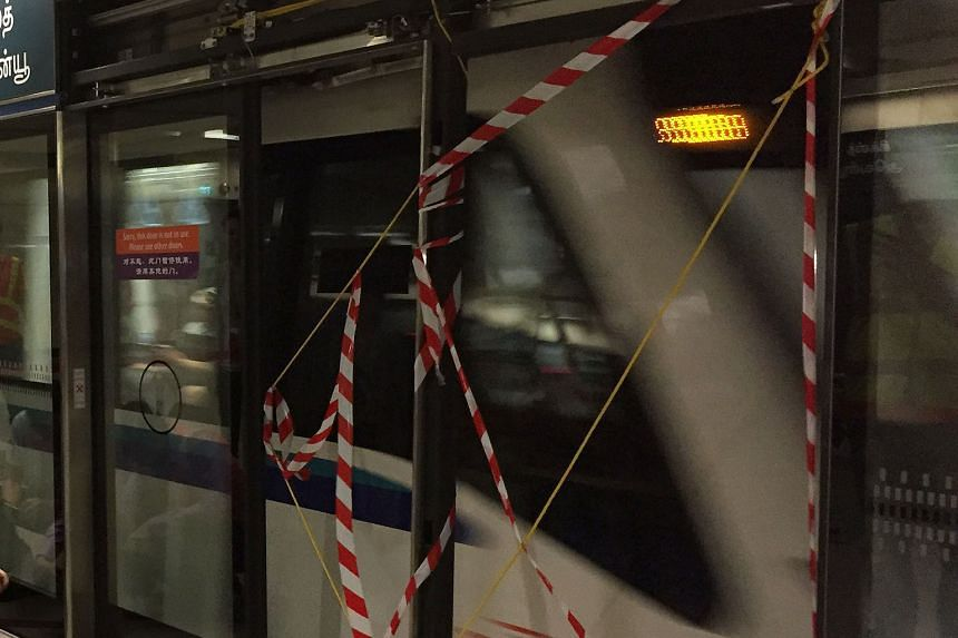 Safety tape was put across the gap where the station platform screen door used to be (left), with the affected section at the Sixth Avenue Station cordoned off. The two-hour stoppage yesterday was the fourth major rail incident in five weeks. SBS Tra