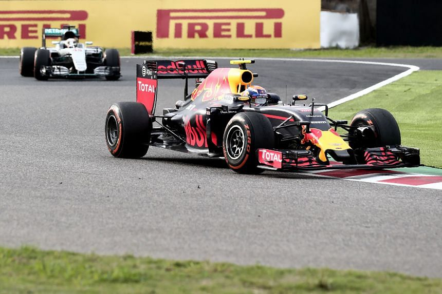 Red Bull's Max Verstappen just ahead of Mercedes rival Lewis Hamilton during the Japanese Grand Prix. Mercedes lodged a protest over an aggressive block by the Dutch teenager near the end of the race before withdrawing it under two hours later, as th